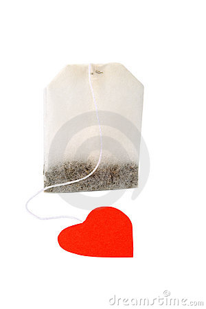 Tea bag with heart-shaped red label isolated