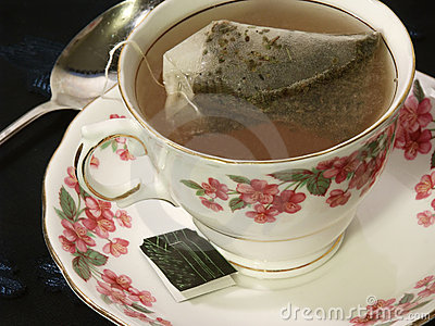 Tea bag steeping in a floral teacup