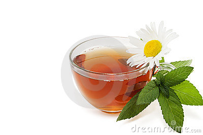 Tea with a branch of mint and a camomile flower Stock Photo