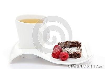 Tea with brownies and raspberries