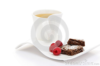 Tea with brownies and raspberries