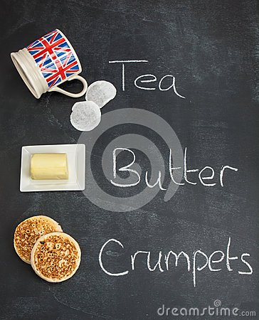 Tea butter and crumpets on a blackboard