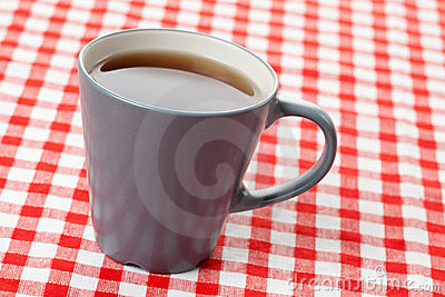 Tea on checkered tablecloth