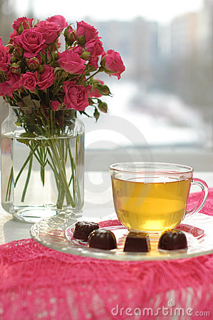 Tea, chocolates and pink roses