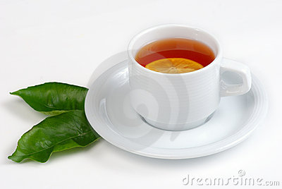 Tea cup and leaves of lemon