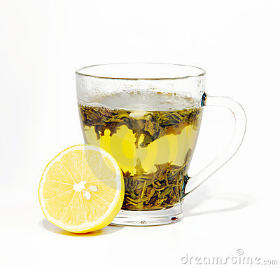 Tea in cup and lemon