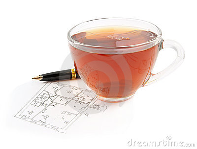 Tea cup and pen on plan