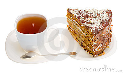 Tea cup and piece of home made honey cake