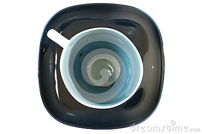 Tea cup with a spoon on the saucer