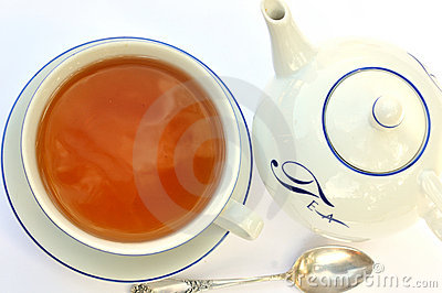 Tea cup, spoon and teapot