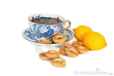Tea and dray rings cookies and lemons.