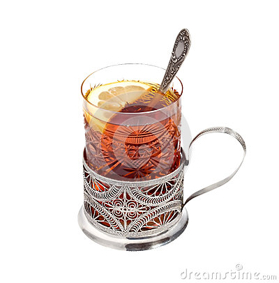 Tea glass with a lemon in a  glass-holder