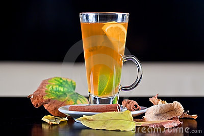 Tea glass with lemon and lime slices inside