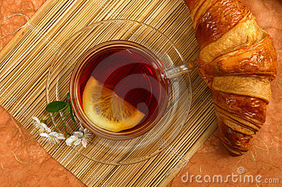 Tea with lemon and croissant