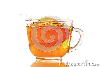 Tea and lemon with splash