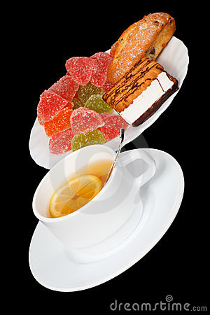 Tea with a lemon and sweets