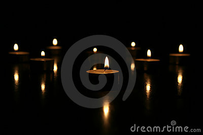 Tea lights on black background