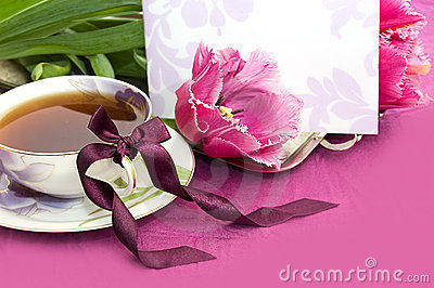Tea and magenta tulips with blank note