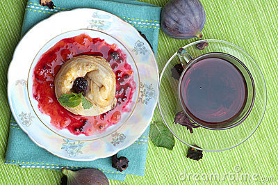 Tea, pancakes with bilberry jam
