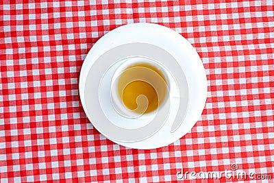 Tea on plaid fabric