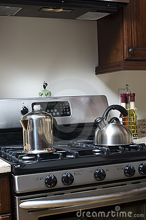 Tea pot and coffee pot on stove