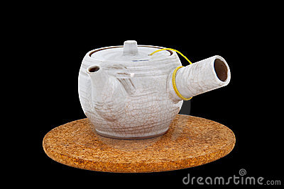 Tea pot with place mat on isolation