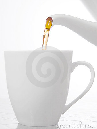 Tea pouring into a cup