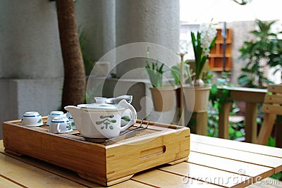 Tea set on a small wooden table