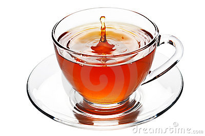 Tea splash in glass cup isolated