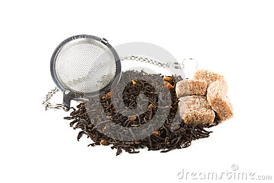 Tea-stainer with tea and brown sugar