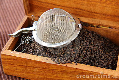 Tea strainer with a black tea