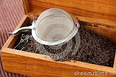 Tea strainer with a black tea
