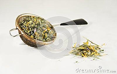 Tea-strainer full of herbs