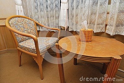 Tea table and chair in hotel room