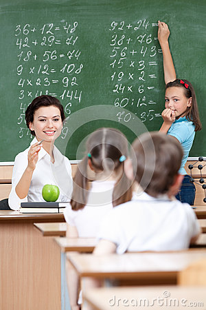 Teacher asks pupils at the chalkboard