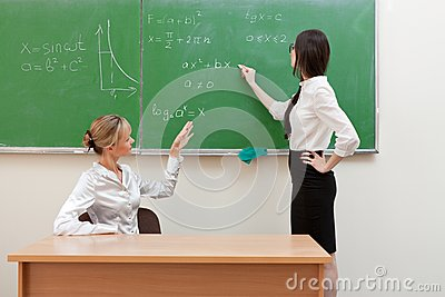 Teacher Asks Student At Blackboard Stock Photos - Image: 25352633