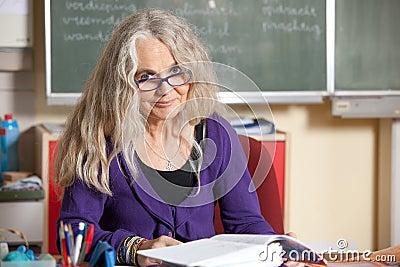 Teacher behind her desk