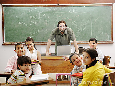 Teacher in classroom with his little student