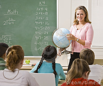 Teacher explaining globe to students