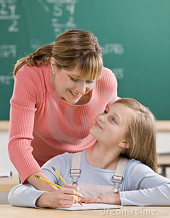 Free Teacher Explaining Homework To Student Royalty Free Stock Images - 6581429