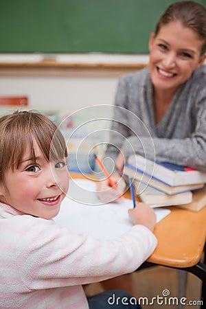 A teacher explaining something to her pupil