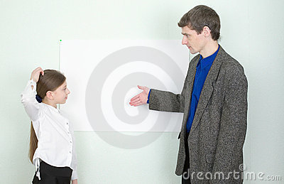 Teacher explains something to the schoolgirl