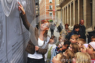 Teacher guiding her pupils in a field trip Editorial Photography