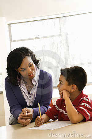 Free Teacher Helping Boy With Schoolwork Stock Photography - 12536022