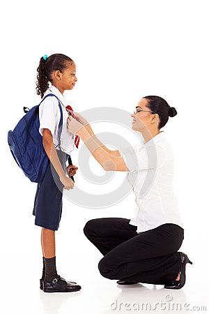 Teacher helping schoolgirl