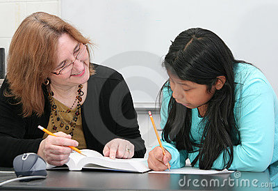 Teacher helping student