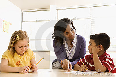 Teacher Helping Students With Schoolwork