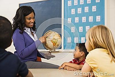 Teacher Holding Globe