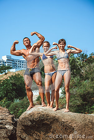 Free Teacher On Fitness With The Pupils On A Beach Stock Images - 72053774