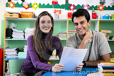 Teacher and parent in classroom